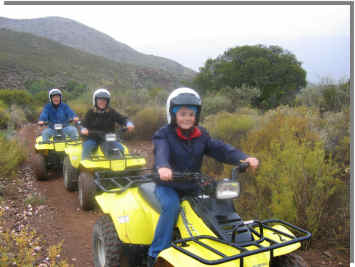 Fun for 3 generations: Grandson, mother and grandfather on quad bikes